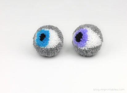 pompony oczy