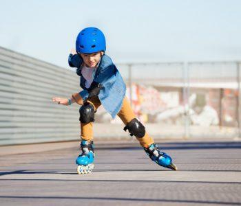 Boy,Riding,On,Roller,Skates,At,Outdoor,Skate,Park